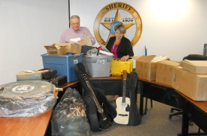 Photo: Parker County Sheriff's Office Parker County Sheriff Larry Fowler and Evidence Technician Dedra Vick sort and log evidence recovered from a local hotel and a storage facility rented by the suspect in a theft case, where the suspect stole packages which were delivered to local residences throughout Parker County and surrounding areas.