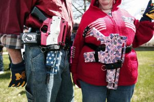 Photographer: Bill Pugliano/Getty Images  Decorated Olympic Arms .223 pistols at a rally for supporters of Michigan's Open Carry law on April 27, 2014 in Romulus, Michigan.