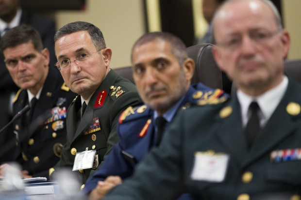 Turkish Lt. Gen. Erdal Ozturk, second from left, and others listen as President Obama speaks during a meeting with more than 20 foreign defense ministers Tuesday at Andrews Air Force Base in Maryland. (Evan Vucci/AP)