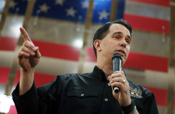 FILE - In this July 14, 2015 file photo, Republican presidential candidate, Wisconsin Gov. Scott Walker, speaks during a campaign event at a Harley-Davidson dealership in Las Vegas. The Wisconsin Supreme Court on Thursday ended a secret investigation into whether Republican Gov. Scott Walker's campaign illegally coordinated with conservative groups in winning his 2012 recall election. (AP Photo/John Locher)