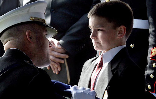 Marine Presenting Flag to Young Son.jpeg